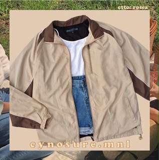 Tan and brown windbreaker jacket