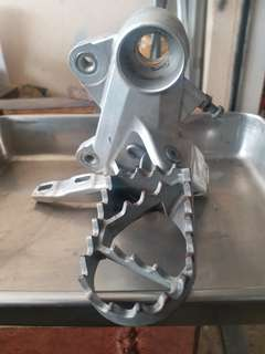 KTM 690 right side front footrest bracket with footrest assy.