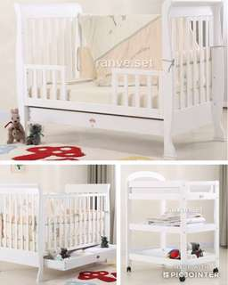 Sleigh cot plus change table