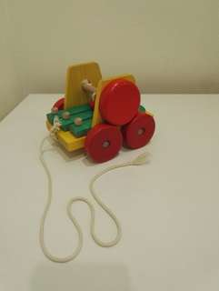 Wooden musical wheels toy