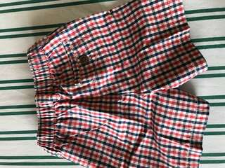 blue and red checkered shorts