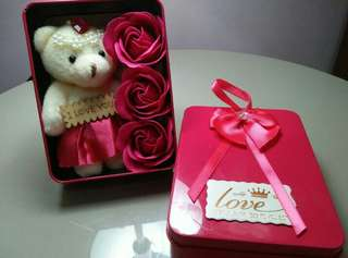 Cute bear and scented flower in a box