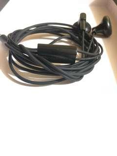 Black rubber corded earphones