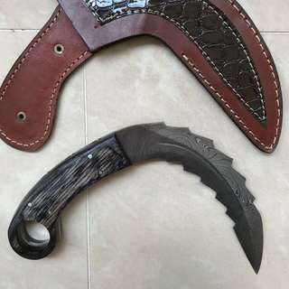 Large jagged karambit ( Curved knife)