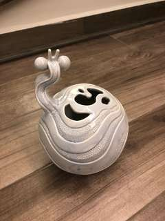 Ceramic snail sculpture, funny looking
