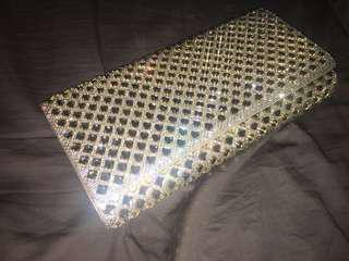 Gold Aldo clutch never used
