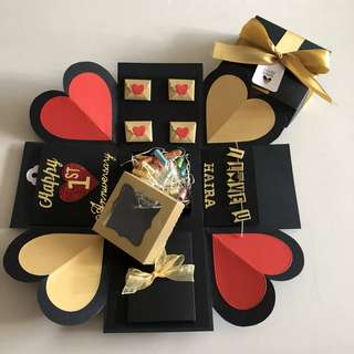 Explosion box with capsule box , pull tab in black , gold and red