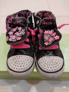 Pink and black sketchers boots
