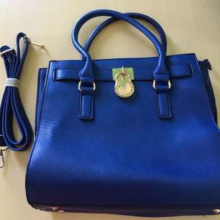 Brand new blue soft leather bag with strap
