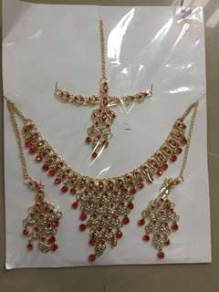 Red necklace with maang tikka