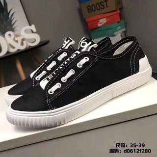 Chanel black canvas shoes