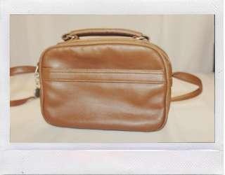 Vintage old brown sling bag