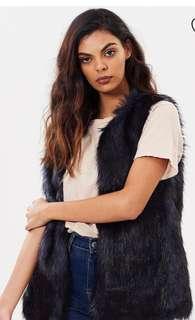 Unreal Fur midnight vest in size medium