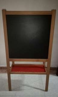 Double - sided white /black board easel.