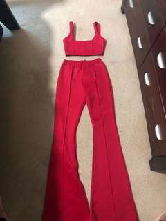 Red high waist extreme flare long leg trousers
