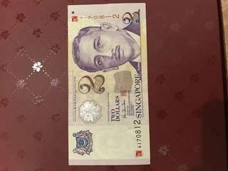 Singapore Currency $2 note with a red chop on TOP right Hand corner