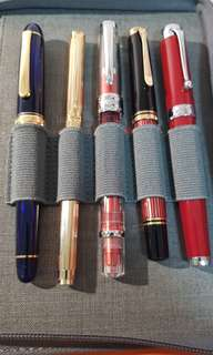let go various fountain pens [on overseas trip, all suspend]