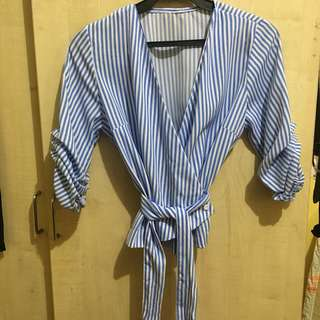 Blue and white striped wrap top
