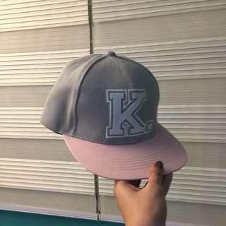 Letter K cap