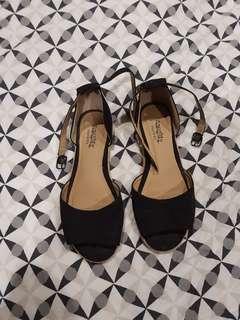 Famous footwear black sandals
