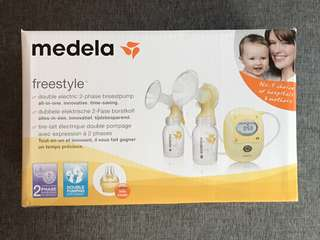 Medela Freestyle Pump with BN Bottles and Simple wishes Pumping Bra