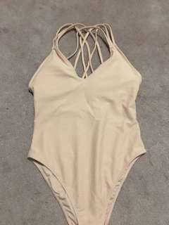 Strappy one piece bathing suit