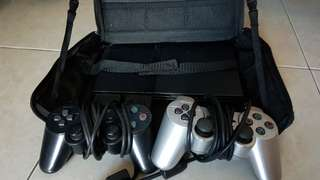 Playstation 2 with controllers