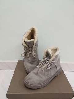 Grey female winter boots