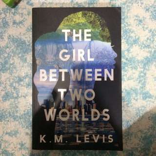 The Girl Between Two Worlds by K.M Levis