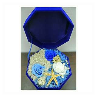 Preserved flowers in a blue box