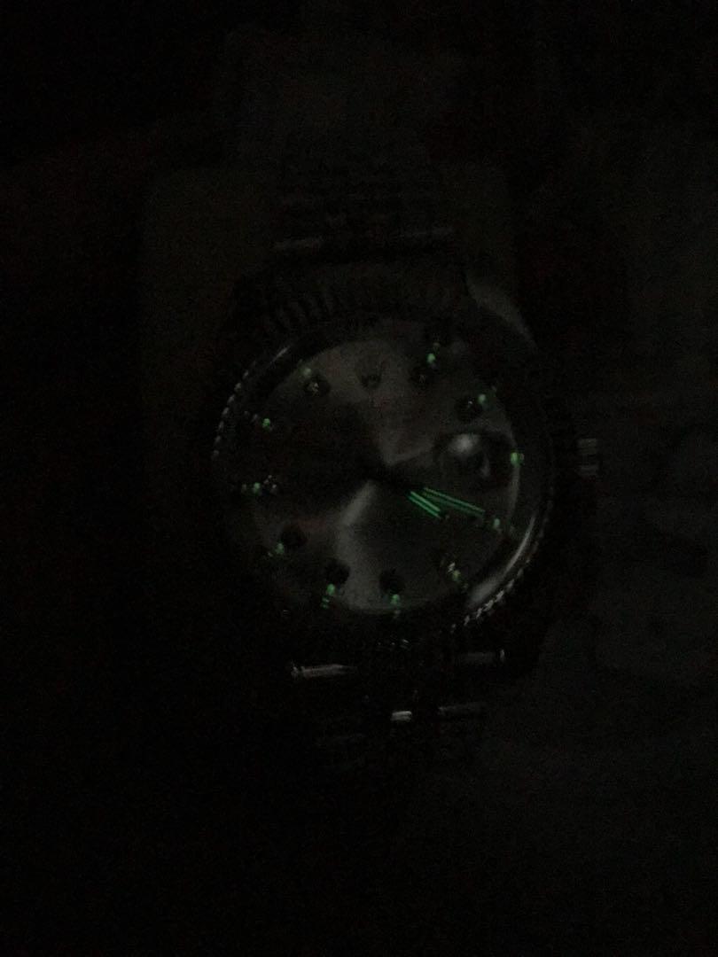 All silver Rolex watch