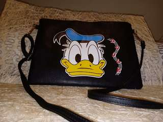 Donald duck Leather sling never been used.
