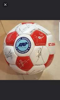 small football with local footballers ' signatures