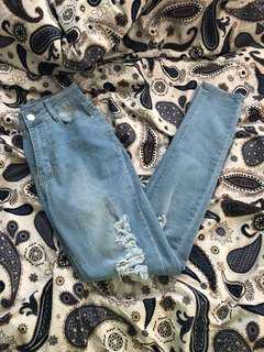 Fashion Nova Light Blue Ripped Jeans