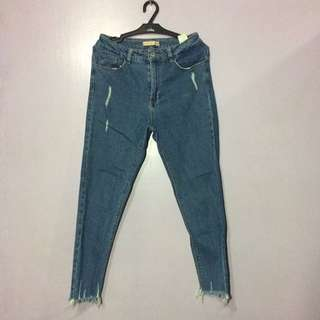 High waist blue tattered jeans