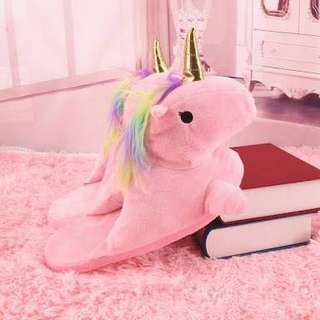 Pink unicorn slipers with white horn