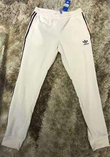 White reflective adidas pants