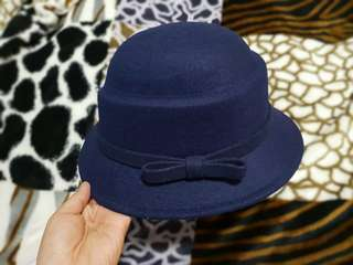 Folded & Hung Bowler Hat with Ribbon