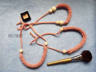 Knitted cord necklaces with wooden beads
