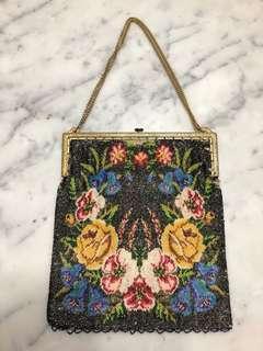 Vintage beaded handbag with metal clasp and chain