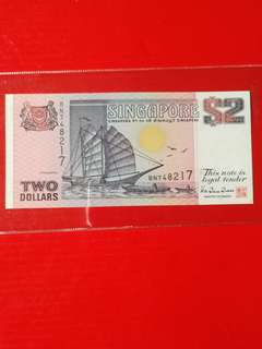 Singapore very RARE  $2 replacement star.prefix BN AU grade scarce