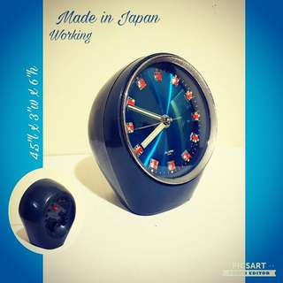 1970s Winding Alarm Clock with Scintillating Blue Dial & Reflective Metallic Digits symbolic of '70s Agogo period. The shape itself is artdeco with a stylish stand. Clock is working, alarm does not work properly. $30 Clearance offer. Sms 96337309.
