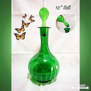 "Unusual Green Glass decanter with Glass Stopper. 13"" tall. Good Condition. $15 Clearance offer. Sms 96337309."