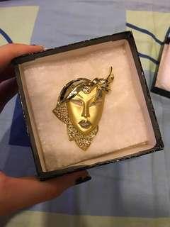 Women face brooch