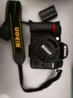 Nikon DSLR D7000 with Nikon Nikkor 50mm lens