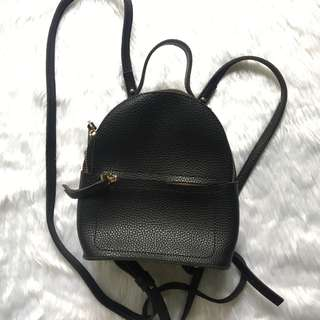 MINISO MINI BLACK AND GOLD BACKPACK