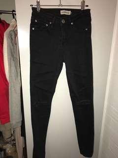 Black slit knee jeans