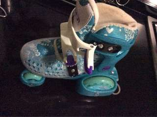 Kids roller skates with safety gear and Elsa helmet