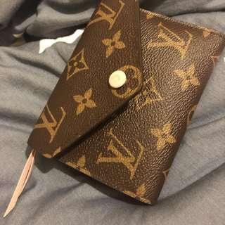 Pink Louis Vuitton wallet