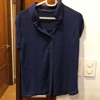 Blue sleeveless button down top